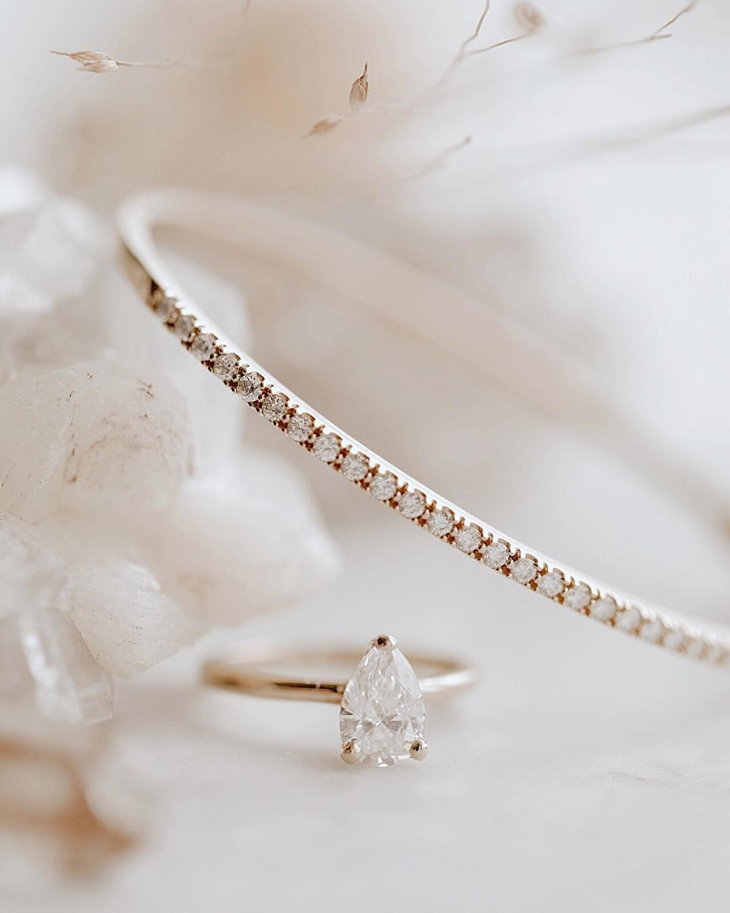We love how this dainty diamond bracelet compliments our stunning pear solitaire in 14k rose gold. ✨