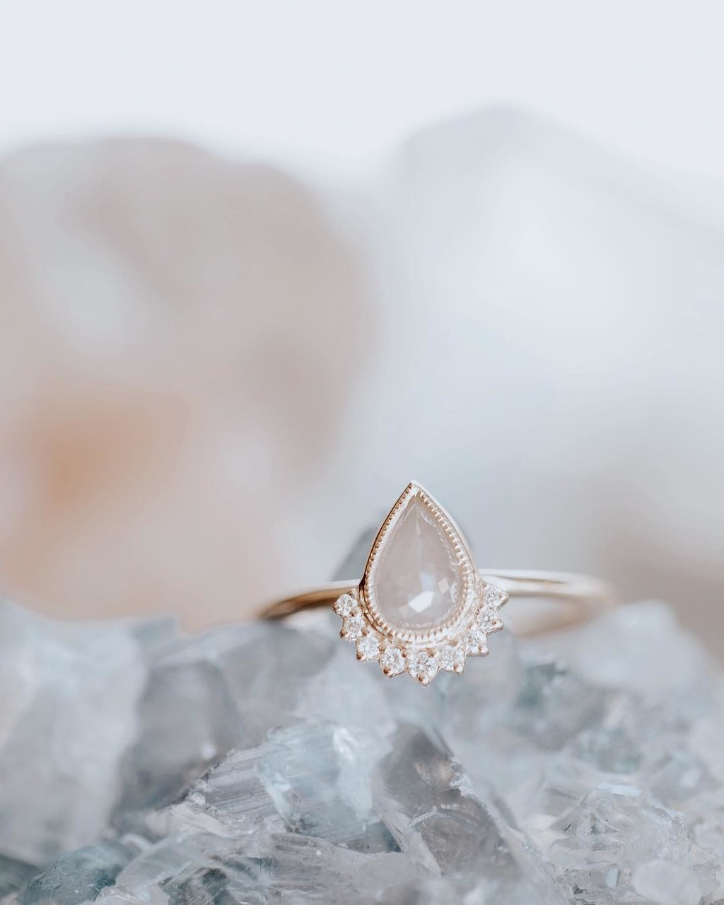 "This ""pearfect"" 14k yellow gold light grey rough diamond ring with a diamond flare is a serious show stopper. Come try this cutie"