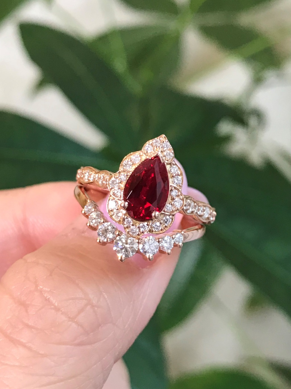 Is your favorite gemstone ruby? Here is our vintage floral pear cut ruby in scalloped diamond band paired with our 7- stone diamond
