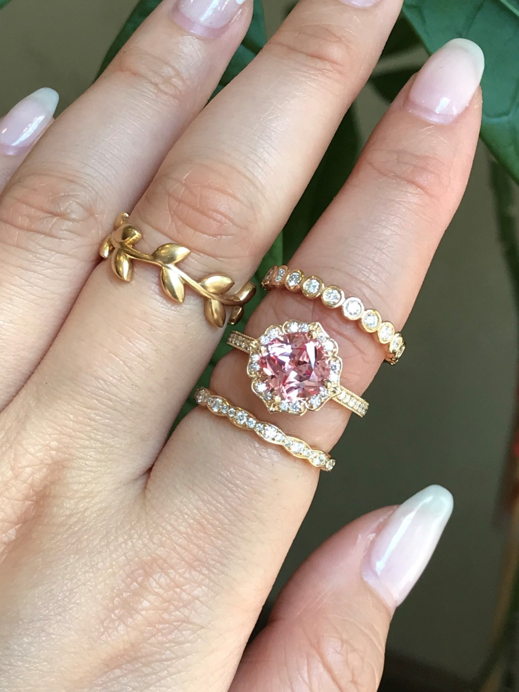 Vintage-inspired peach sapphire engagement ring features an 8x8mm cushion cut conflict free cultured champagne peach sapphire set in