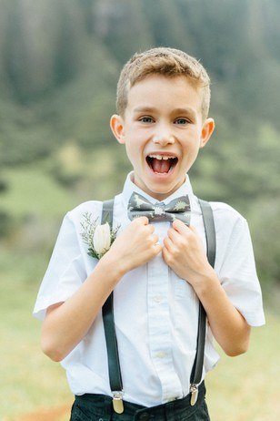 cute ring bearer with dino bow tie