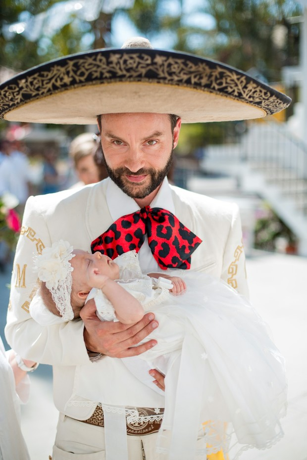 groom and baby in full matador outfit
