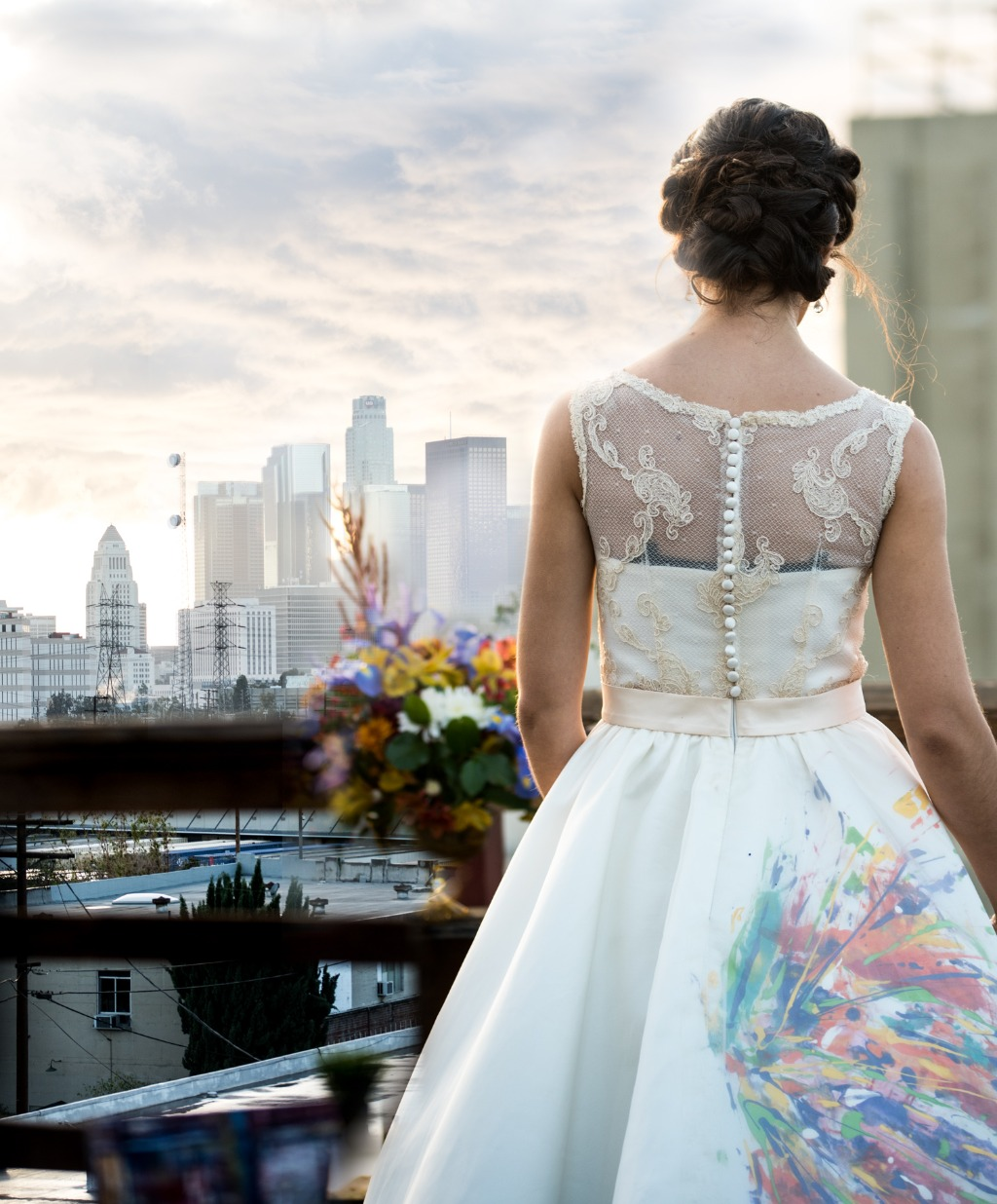 Our groom hand-painted his bride's tea-length dress, creating a unique, beautiful look for their artistic vow renewal.