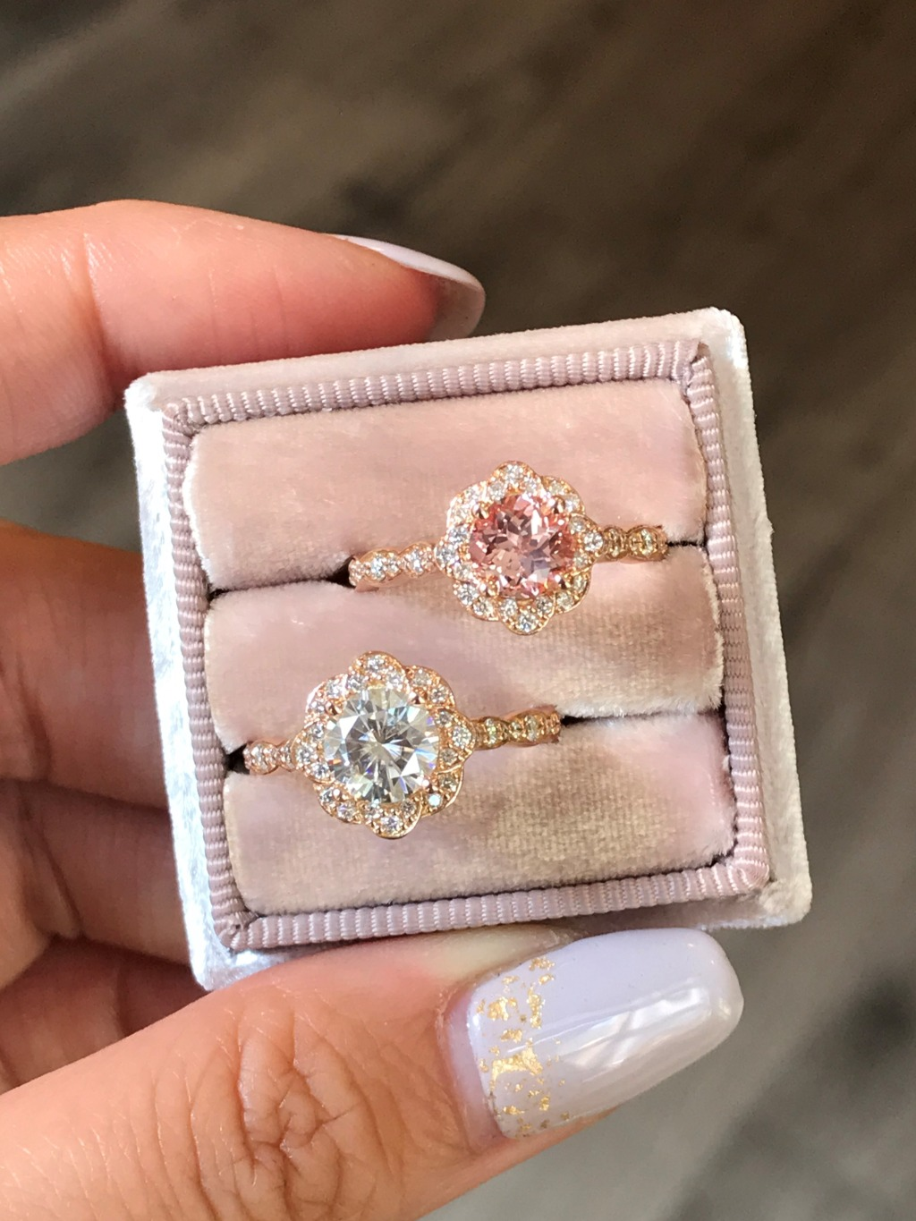 Our Vintage Floral Round Cut Peach Sapphire and Moissanite Rings look like gorgeous little flowers encased in rose gold ~ See the whole