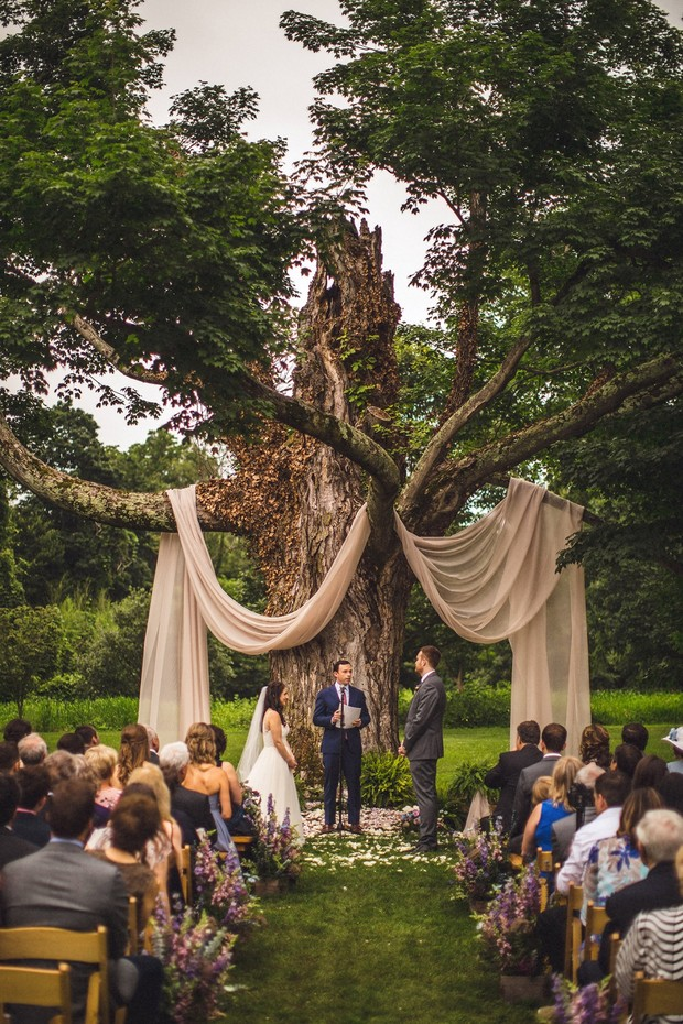 wedding ceremony outside under a tree