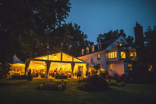 magically lit tented wedding reception