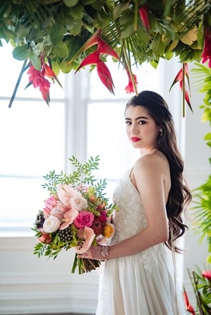 bride with tropical themed wedding