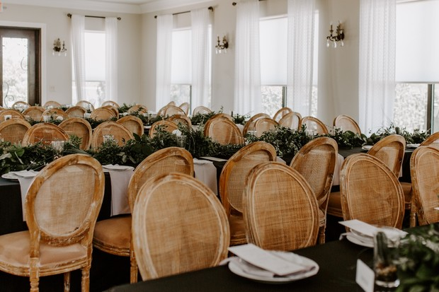 wood and greenery wedding reception