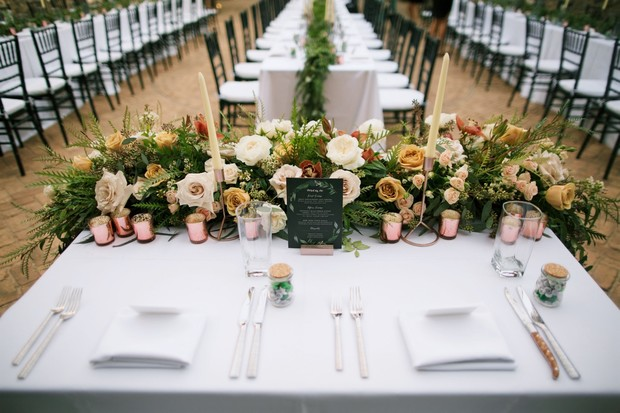 sweetheart table with blush and ivory floral decor