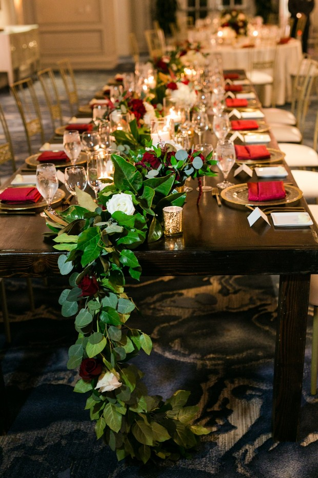 wedding table with rose and greenery garland