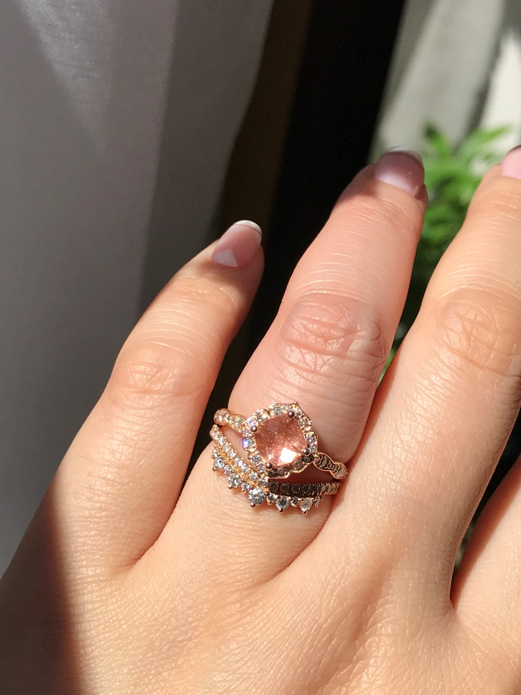 If you're looking for unique, look no further than this gorgeous mini vintage floral sunstone engagement ring topped above a crown