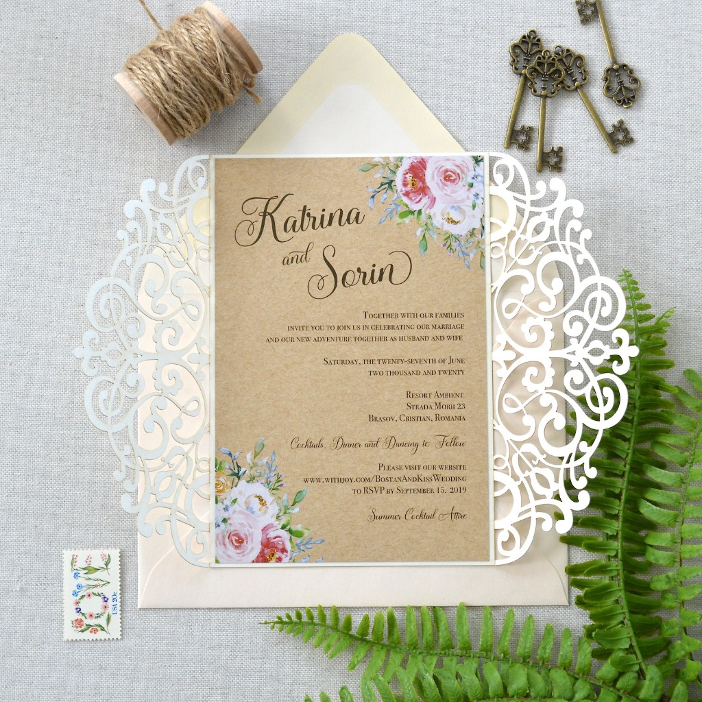 How refreshing is this invite? It just opens up and says HELLO SPRING wedding! Kraft paper invitation with a creamy lasercut fold.