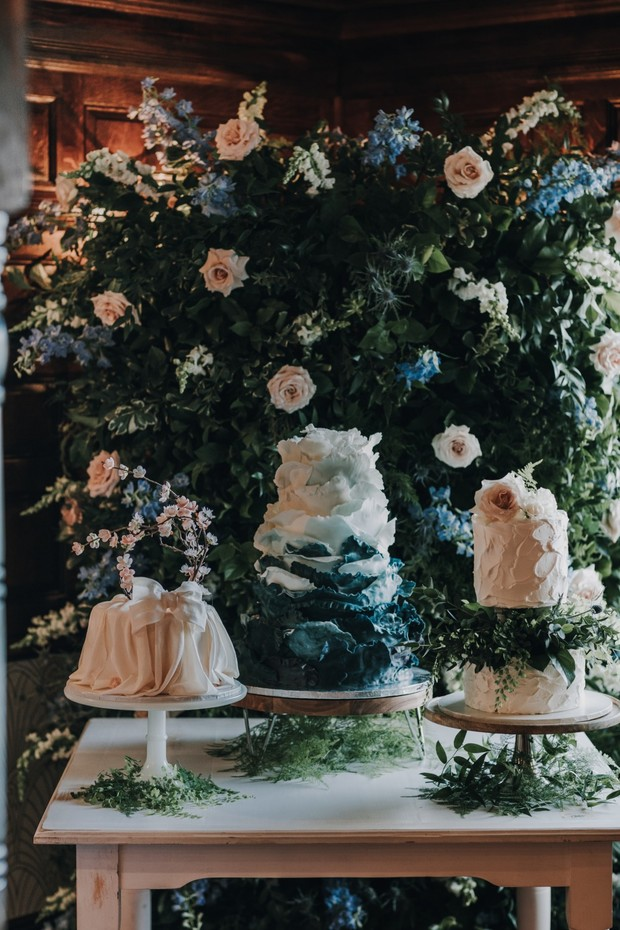 ruffled wedding cakes and floral backdrop