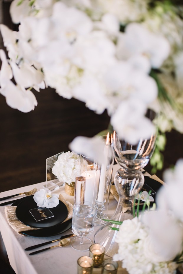 glam black and gold wedding table setting