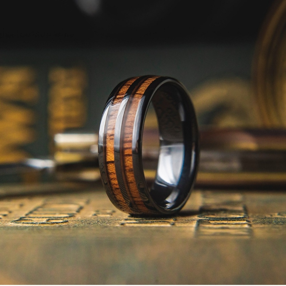 The Vintage Wooden Wine Barrel Ring. This men's wedding ring is crafted out of high tech ceramic and inlaid with natural koa wood.