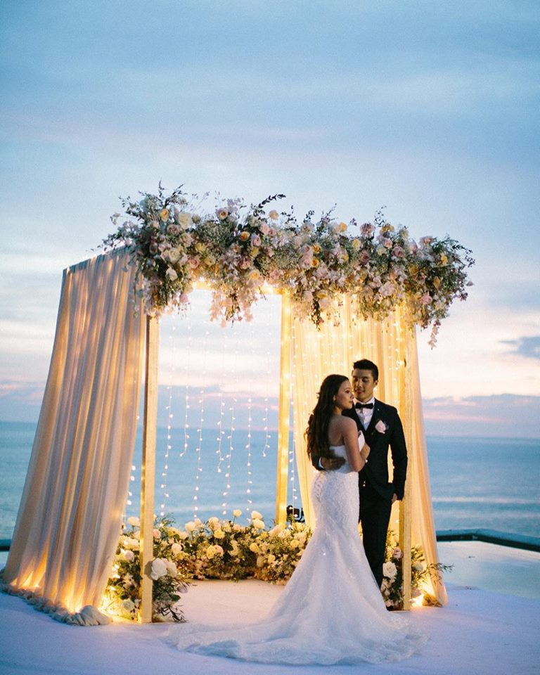 romantic lit ceremony backdrop