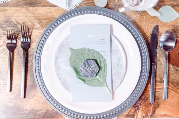 grey and white wedding place setting