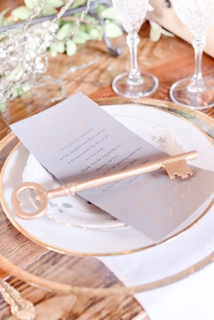 romantic gold and white wedding place setting