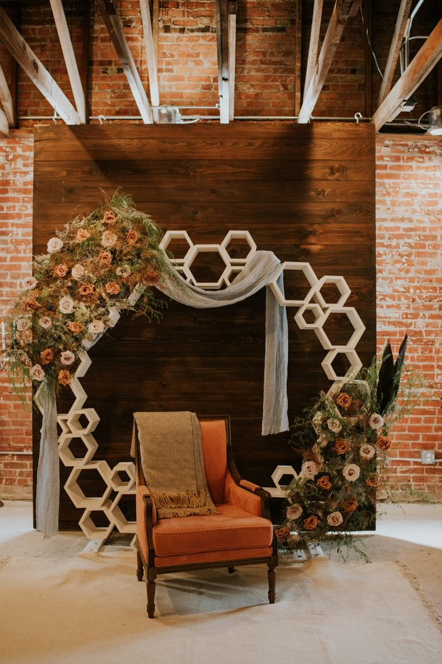 modern and romantic floral wedding ceremony backdrop