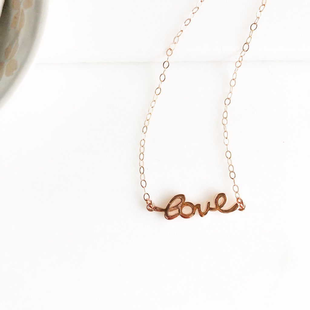 Sweet rose gold necklace that reads love in cursive. 18 long on 14k rose gold filled chain.