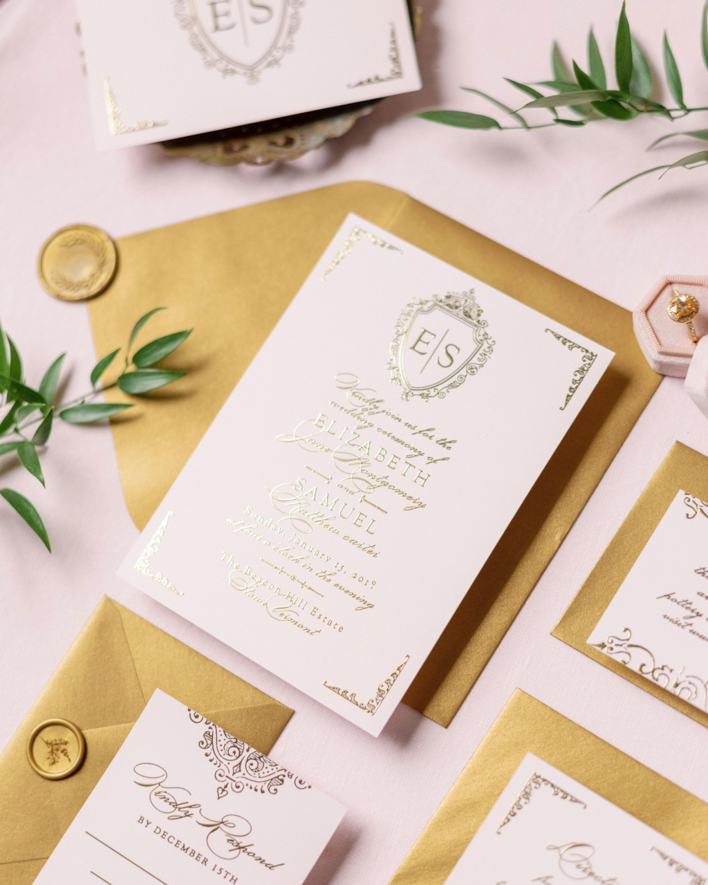 Keep things beautifully classic with a Gold Foil Scrolling monogram wedding invitation!