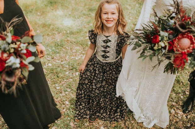 flower girl in floral dress