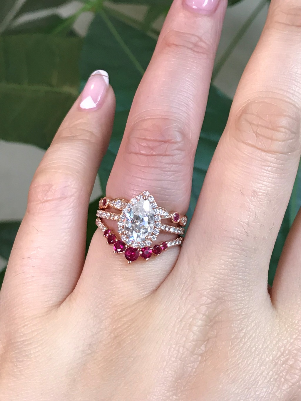 Add colored accents to your bridal ring set by shopping weddings rings by La More Design! Here we stacked a Pear Moissanite Ring in