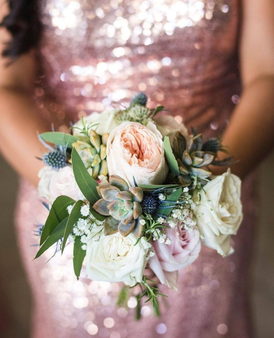 How pretty are these delicate blooms set against this Bridesmaid's pretty rose gold dress?