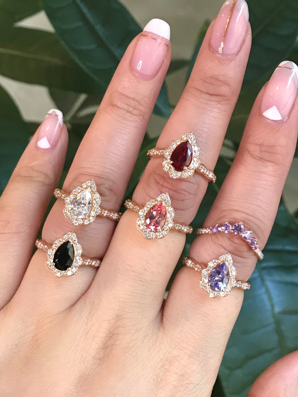 Are you picking a pear engagement ring for your big day? Here are some of our pear cut engagement rings in scalloped diamond band from