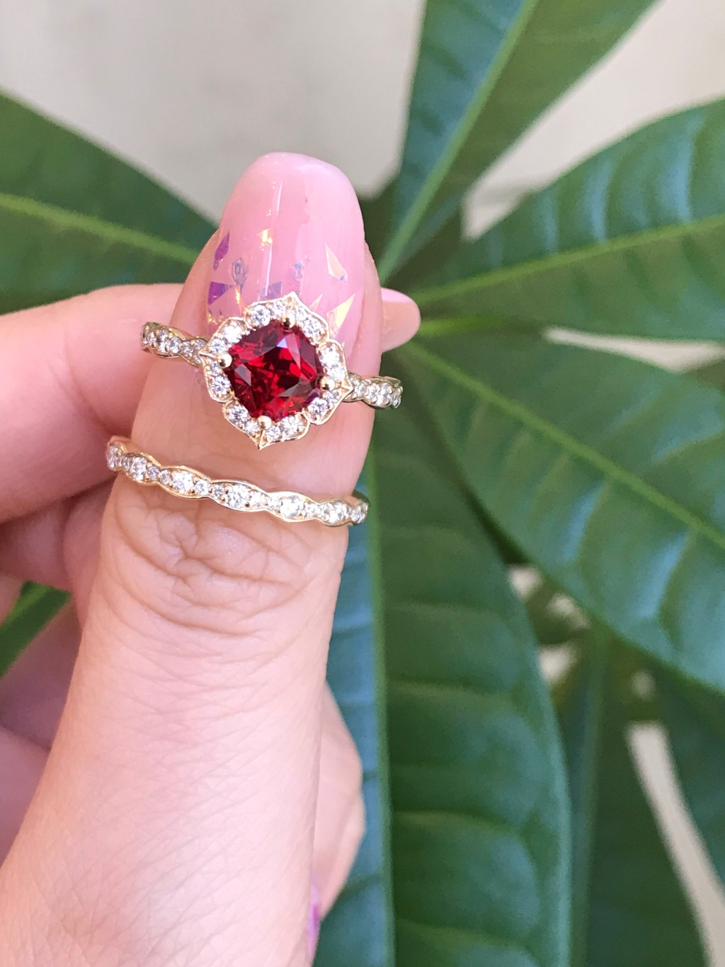 Rubies are red and she is just perfect! She is our cushion cut mini vintage floral ruby ring set in scalloped diamond band paired with