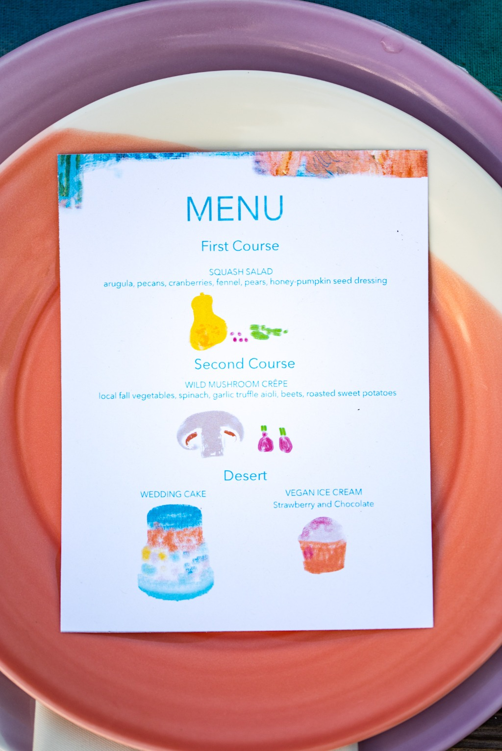 The menu cards for this artistic vow renewal had painted illustrations by a local artist on them to add in whimsical pops of color