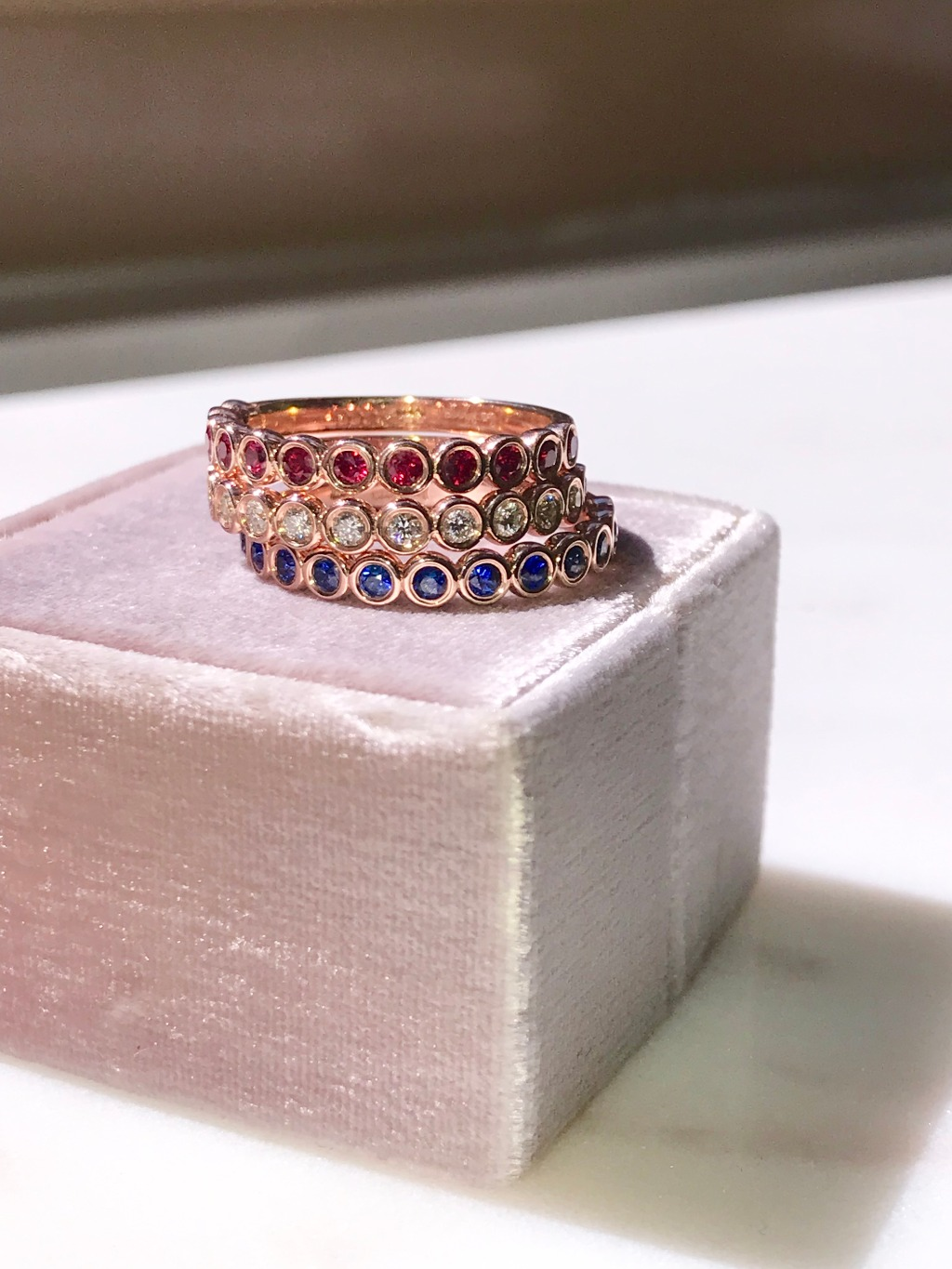 Rubies and diamonds and sapphires, oh my! A little something for every bride in this wedding ring stack of ruby, diamond, and royal