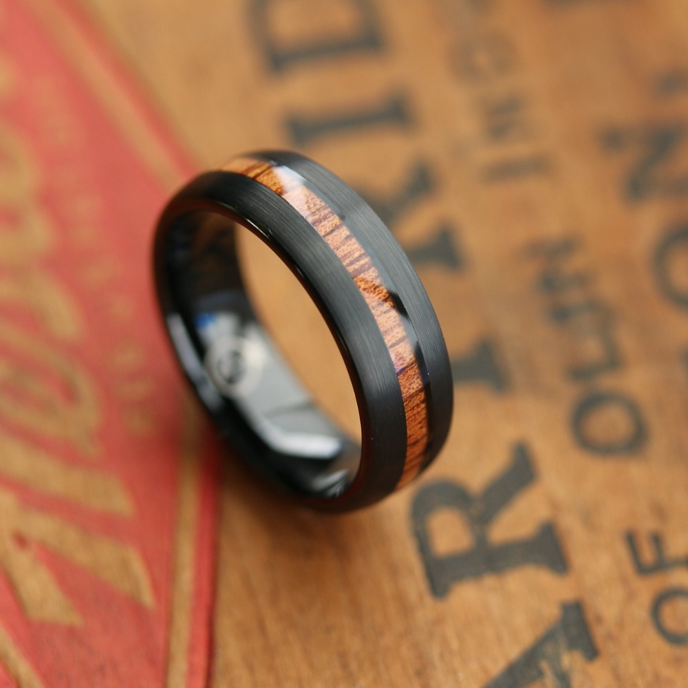Mens black tungsten wooden wedding ring. Inlaid with natural koa wood. The perfect mens wedding ring for those who enjoy the great