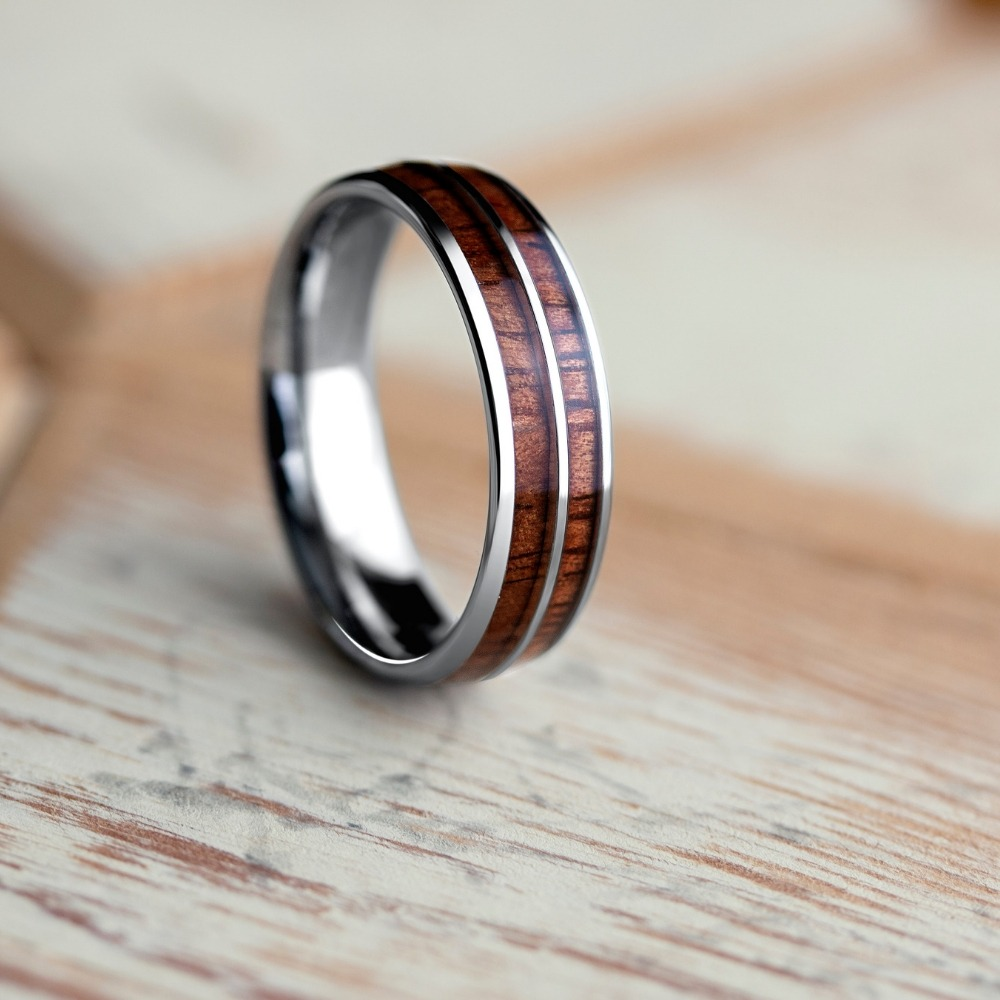 Men's wooden barrel ring. Crafted out of silver tungsten carbide and inlaid with natural koa wood. This ring is also available in 6mm