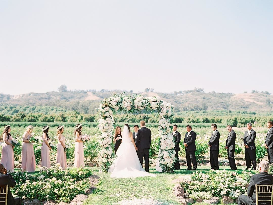 A beautiful ceremony in front of the orchards of @gerryranch under