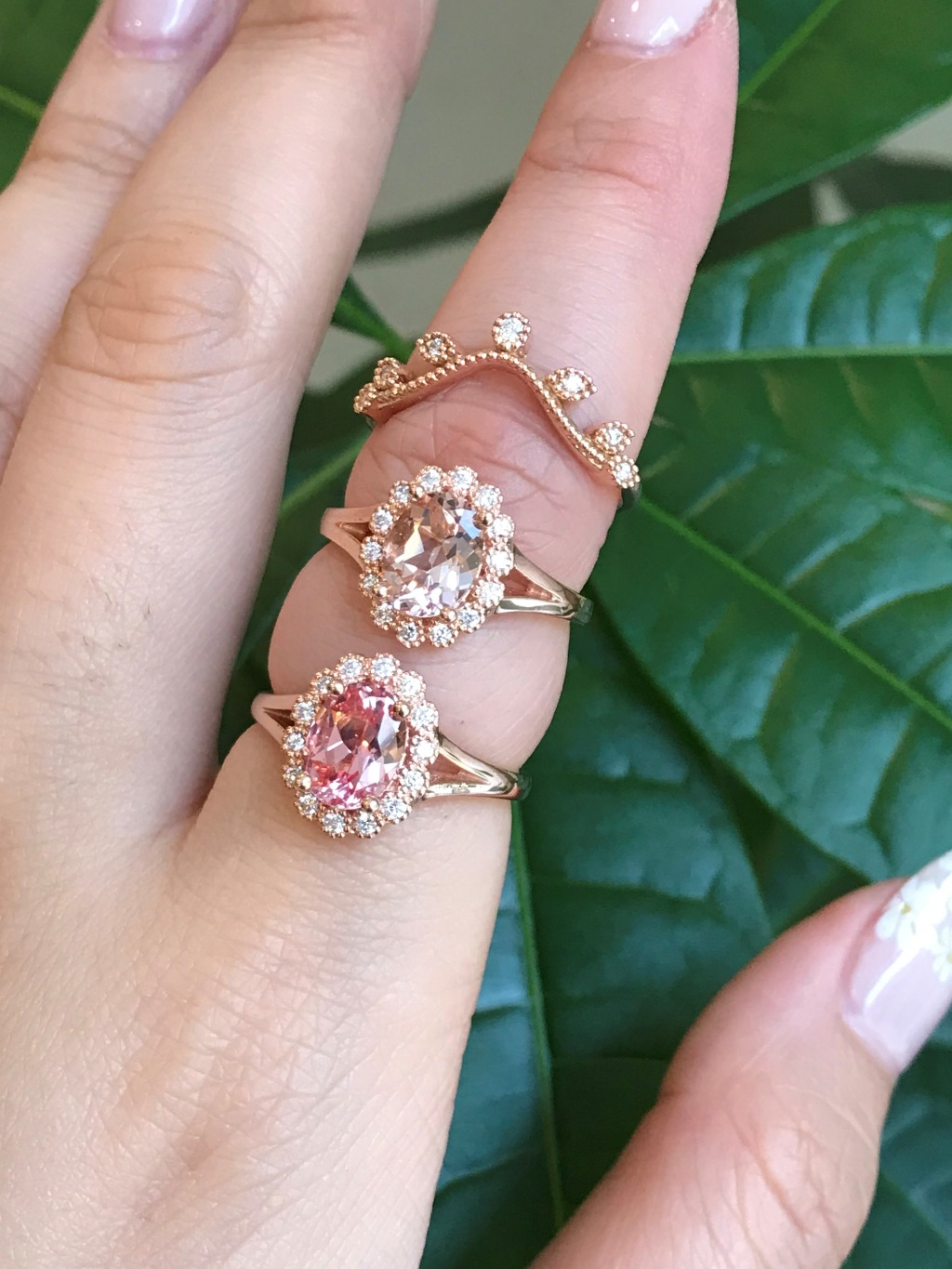 Oval Peach Sapphire on top, Oval Morganite below, both in Vintage Luna Halo design and split shank bands in Rose gold! Which is your