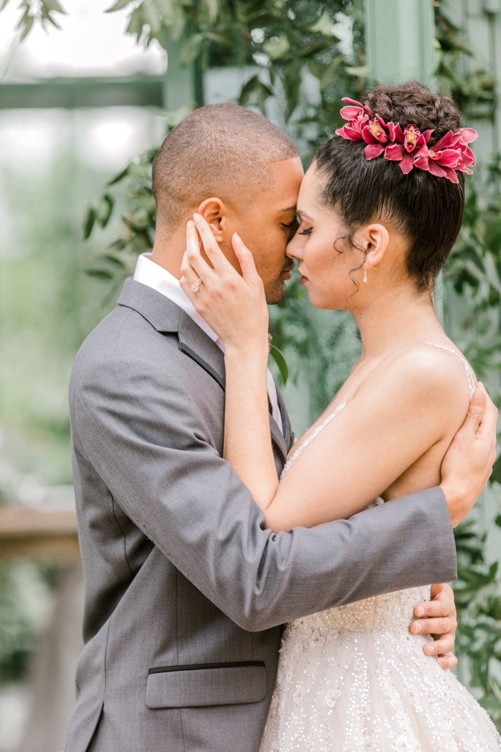 Stunning wedding couple! Love the flowers in the brides hair!