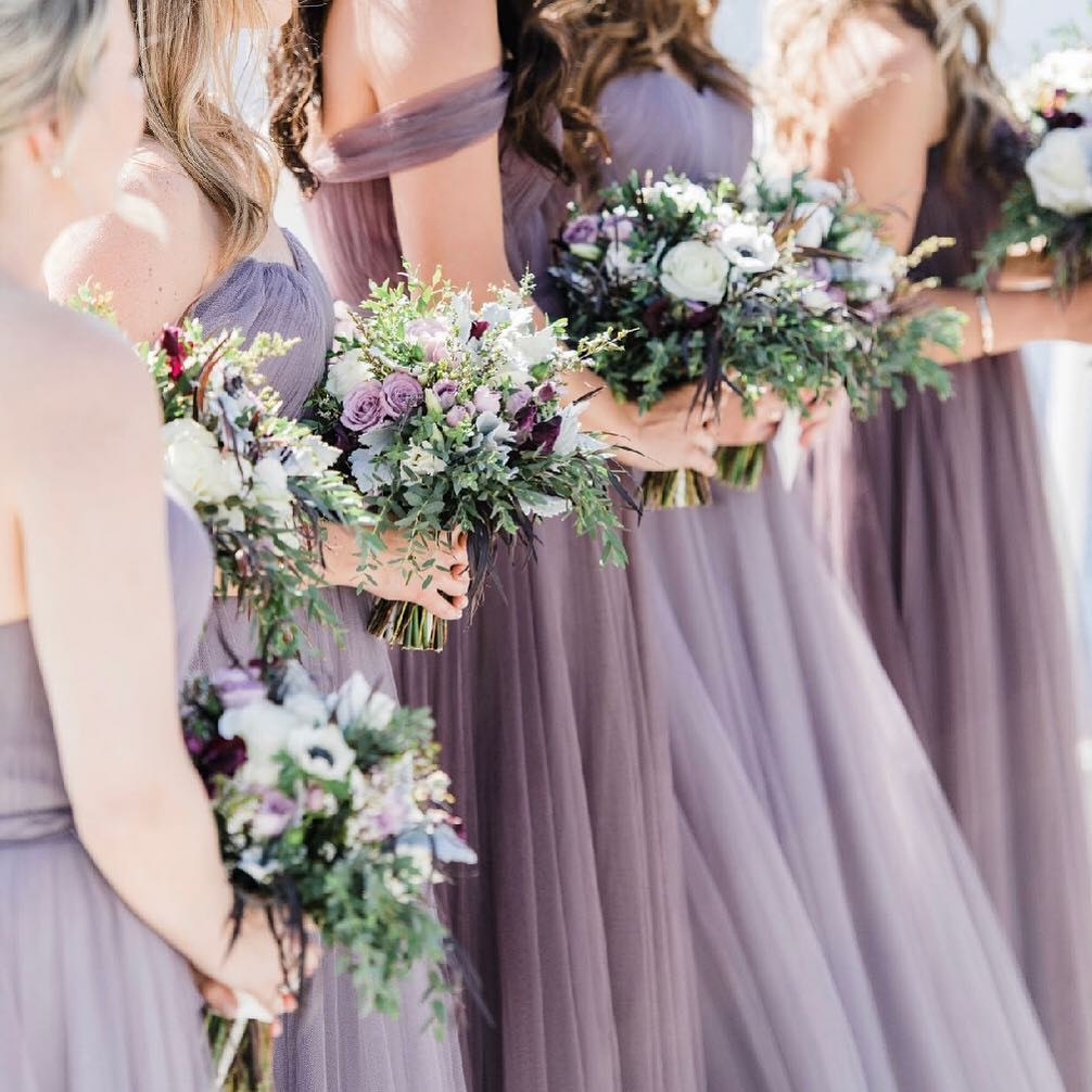 Girls in purple dresses with multiple tulle sashes.💜