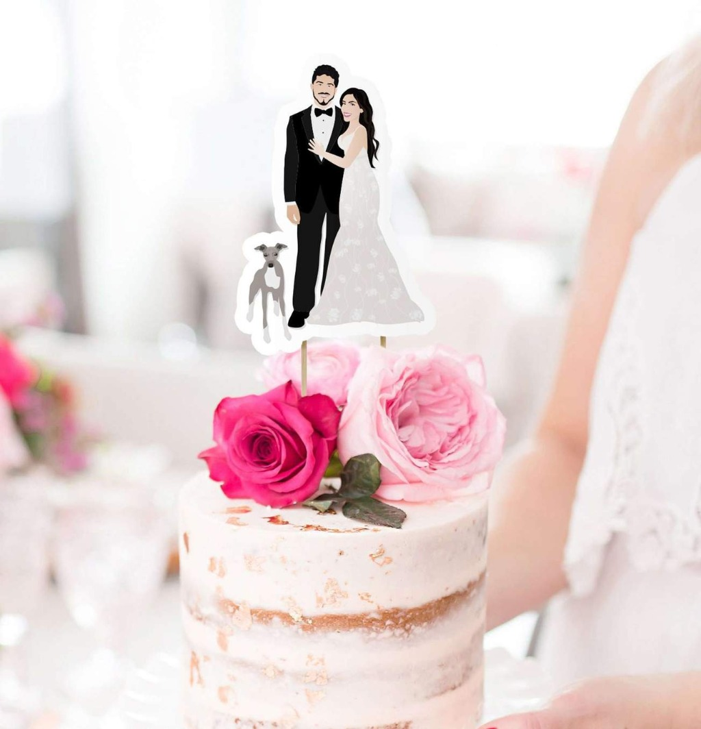 This super fun wedding cake topper features a custom illustration of the couple, and you can even choose to add your pets on!