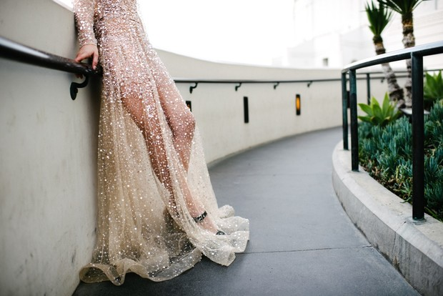 sheer wedding dress with lots of sequins