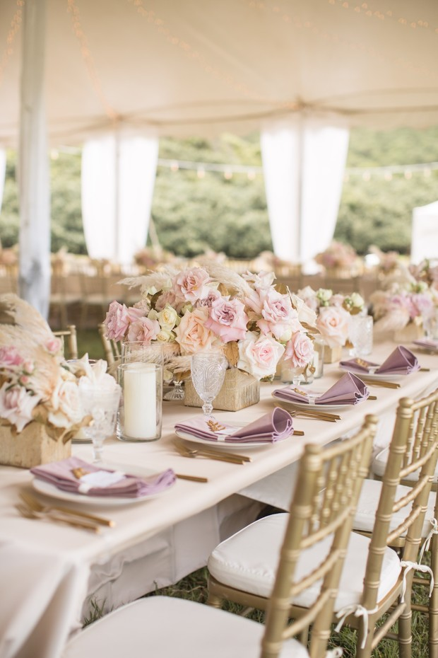 tented wedding reception in pink and gold