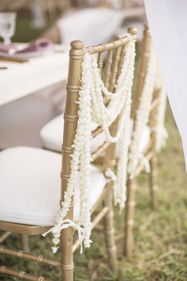 simple flower chain draped seat decor