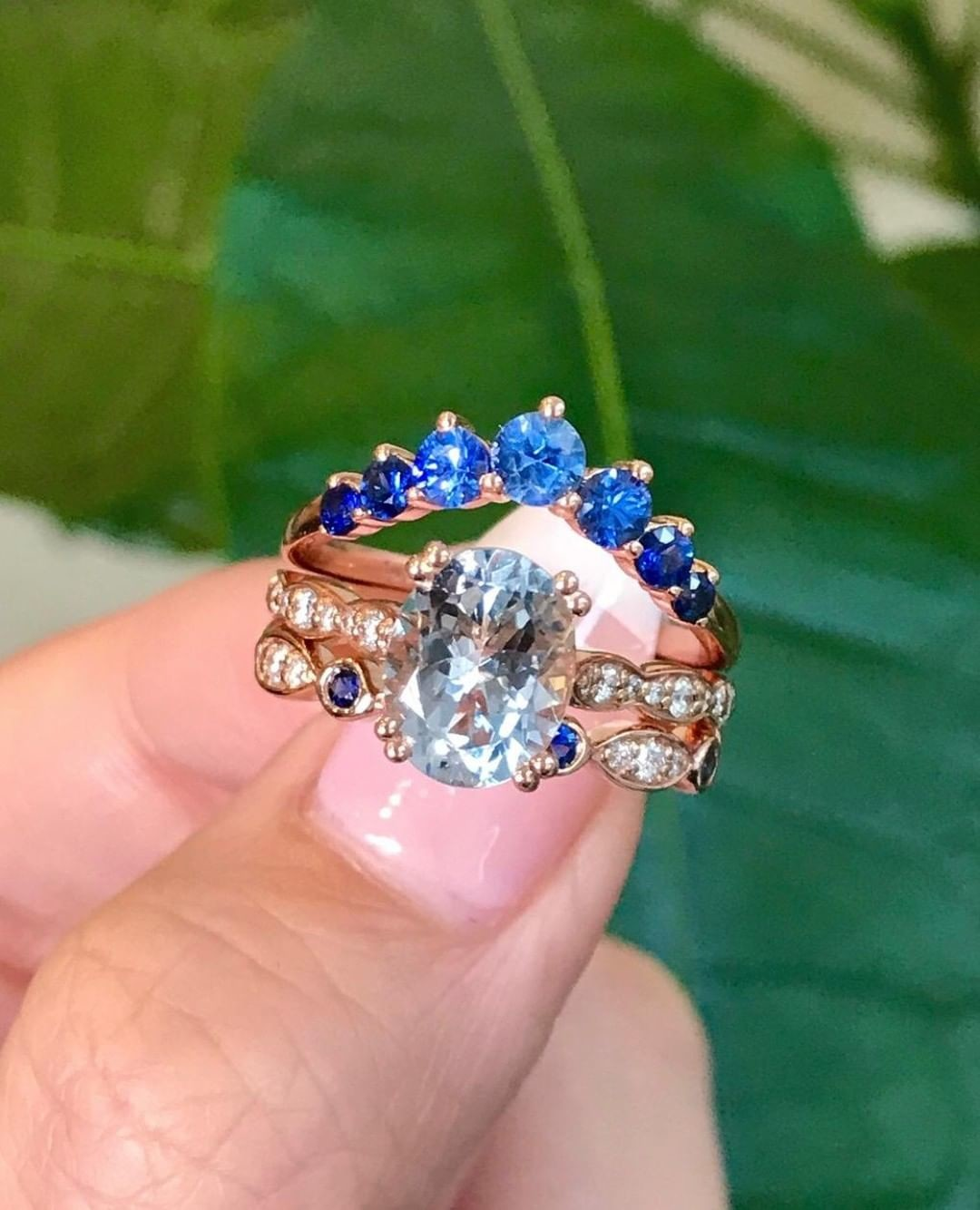The response we've gotten about our 7 Stone Gradient Sapphire Ring has been so loving! 💙 See how she starts light and aqua blue