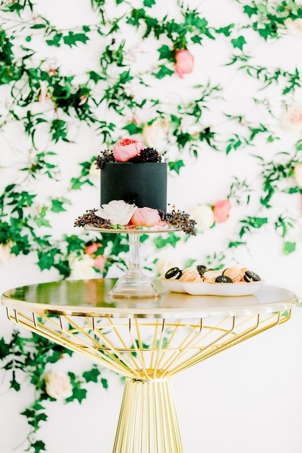 gold and black wedding cake table