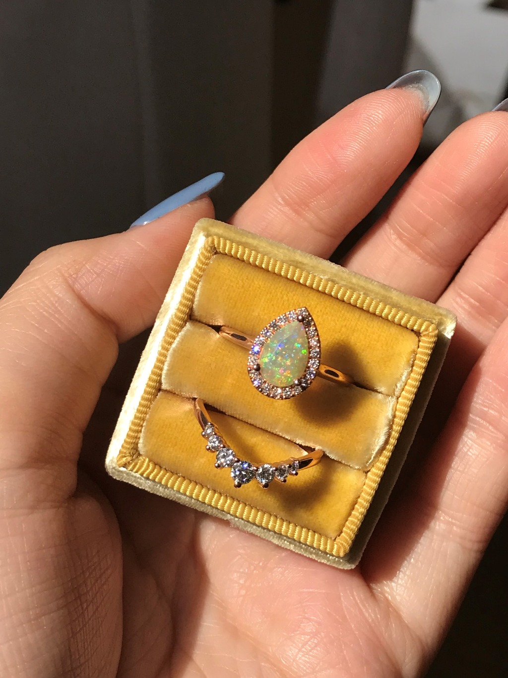 Simply elegant yet stunning! This Opal Bridal Set features a 9x6mm Pear Cut Opal surrounded by sparkling conflict free natural white