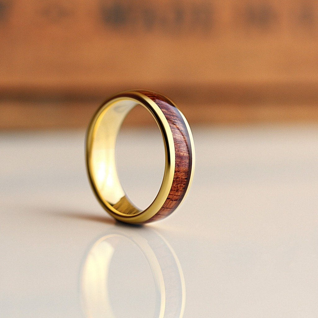 We like to call this men's wedding ring The Wood Class. Classic yellow gold with a natural koa wood inlay. This wooden wedding ring