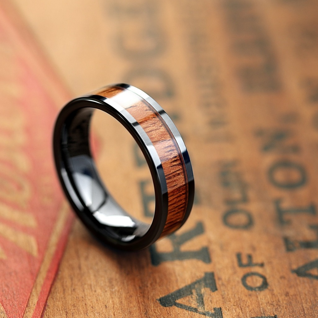 Mens black wooden wedding ring. This men's wedding band features a black high tech ceramic core with a koa wood inlay.