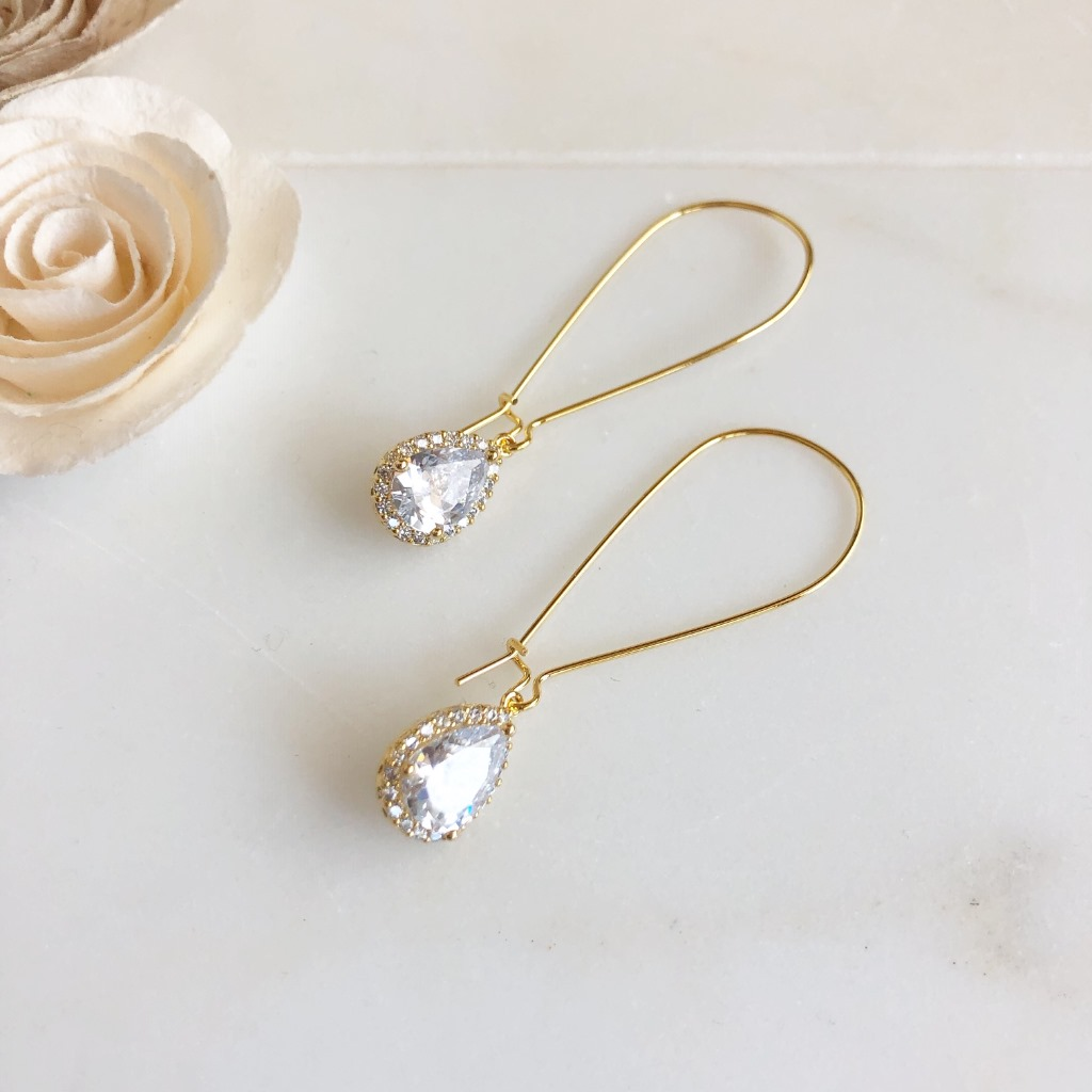 Sweet and simple cubic zirconia drop earrings. They measure just about 2.25 with gold plated brass ear wire.