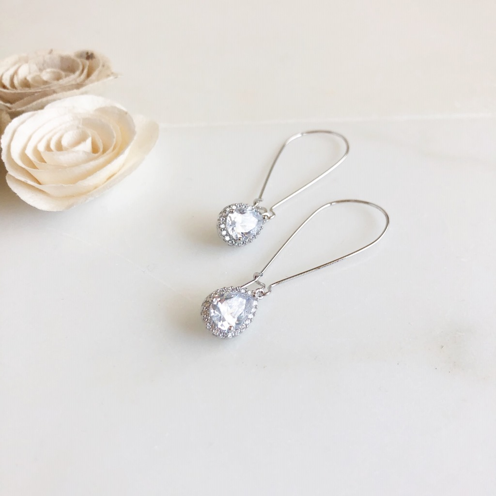 Sweet and simple cubic zirconia drop earrings. They measure just about 2.25 with silver plated brass ear wire.