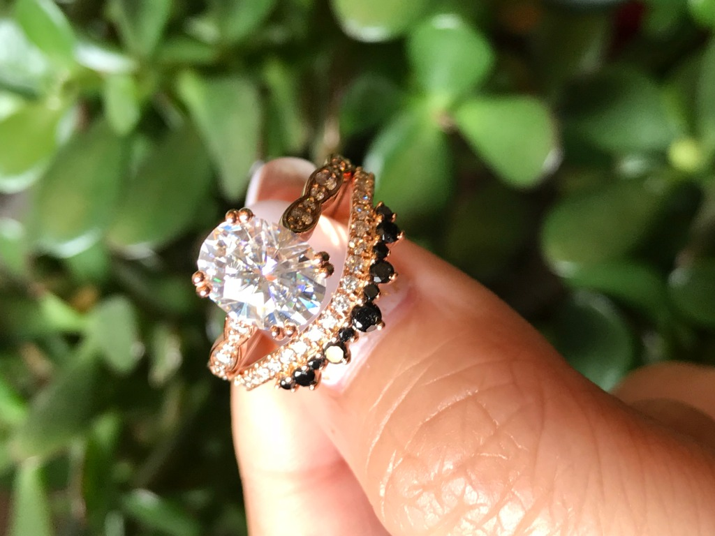 Elegant vintage inspired creation! This moissanite bridal set features a solitaire moissanite engagement ring set in 14k rose gold